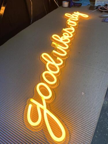 good vibes yellow color neon sign